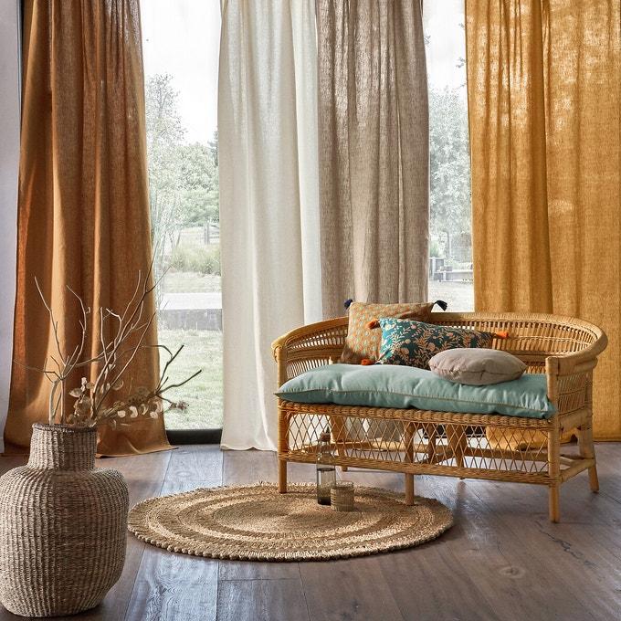 salon bohème avec rideaux en lin de couleur orange et crème