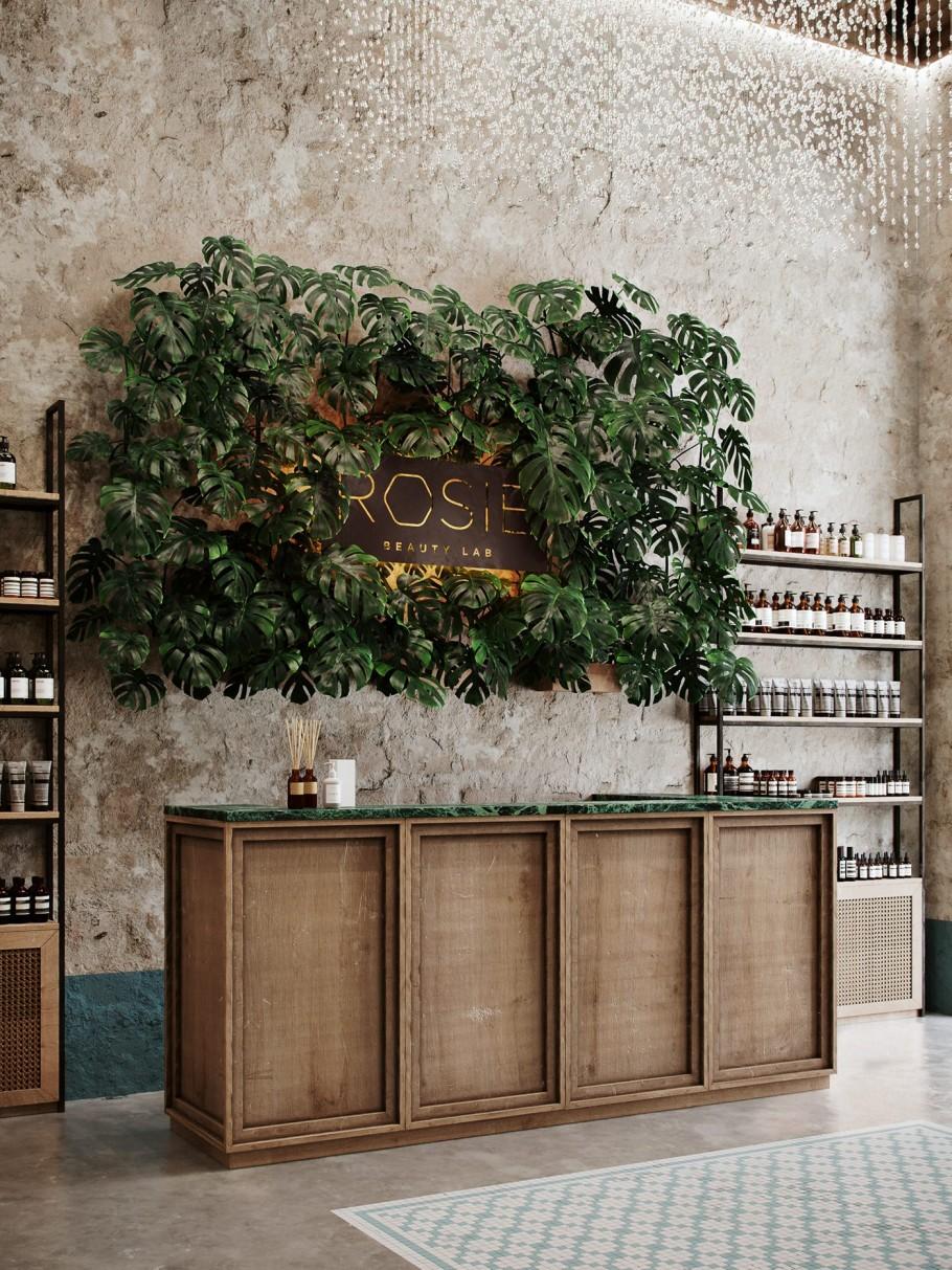 aménagement magasin avec mur végétal surplombant un large comptoir vintage en bois vieilli