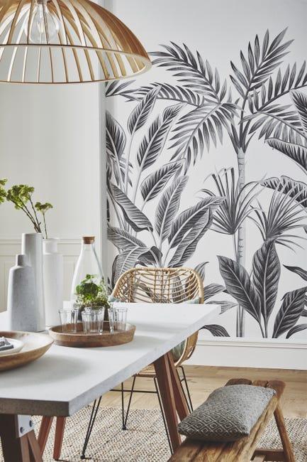 papier peint gris de style jungle tropicale pour cette salle à manger bohème