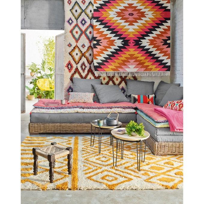 salon ethnique avec tapis à motifs et kelim pour une déco été