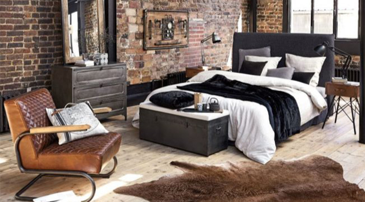 industrial-style-bedroom-with-red-tiles-and-leather-chair